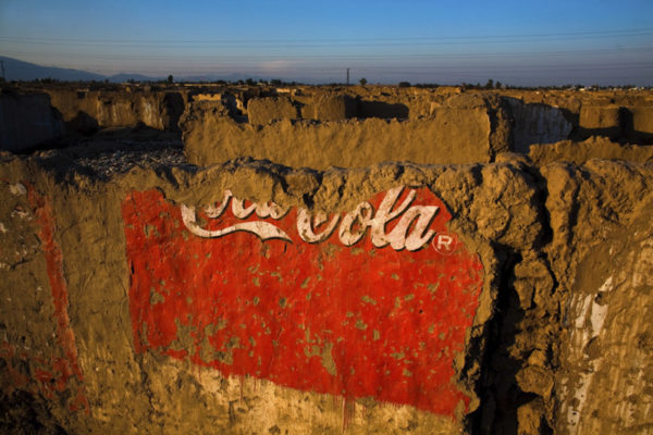 Coca-Cola trade mark is seen on destroyed wall of former refugee camp. More than eighty thousand people from Afghanistan have lived in this camp during the Taliban have ruled. Peshawar, Pakistan, 22nd of January 2008